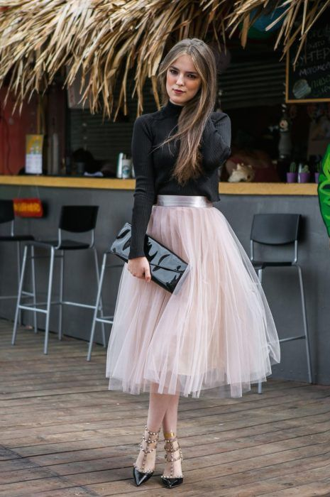 Girl wearing baby pink tulle skirt and black long sleeve blouse