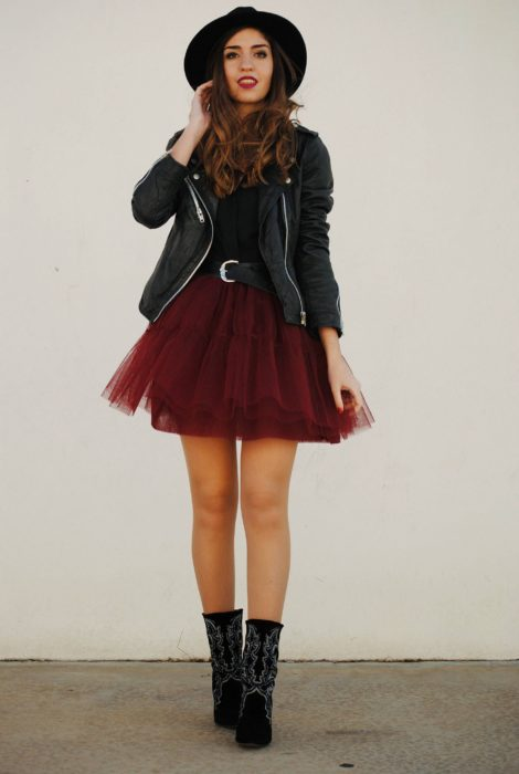 Girl wearing cherry colored tulle skirt with black ankle boots, blouse and leather jacket