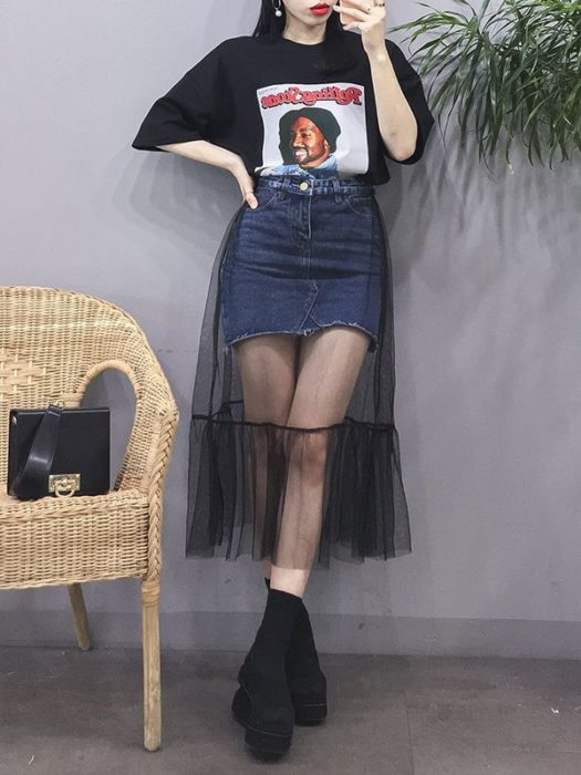 Girl wearing black tulle skirt with mini denim underneath and oversized black shirt