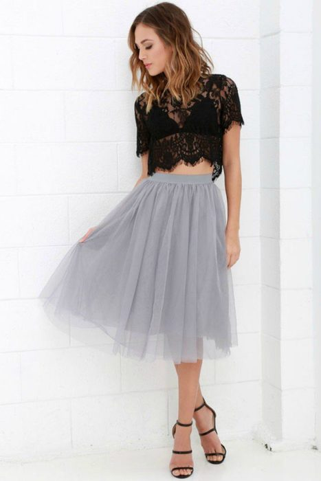 Girl wearing gray tulle skirt, with black lace blouse and black heels