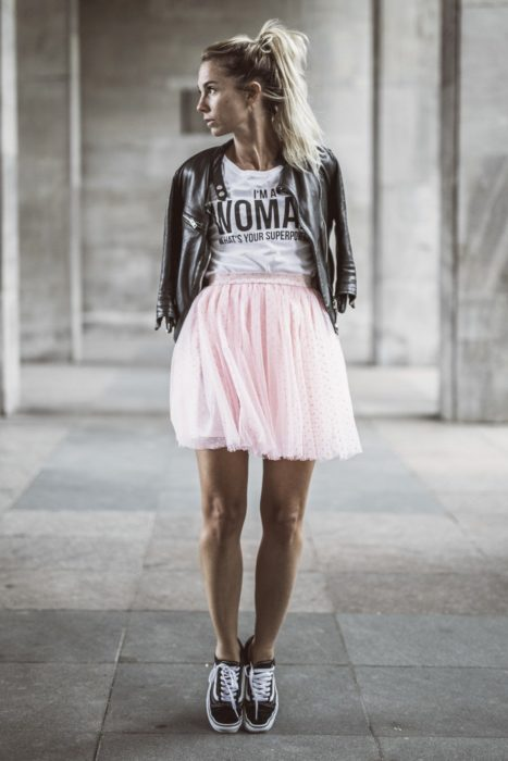 Girl wearing pink tulle skirt and white shirt with a black leather jacket