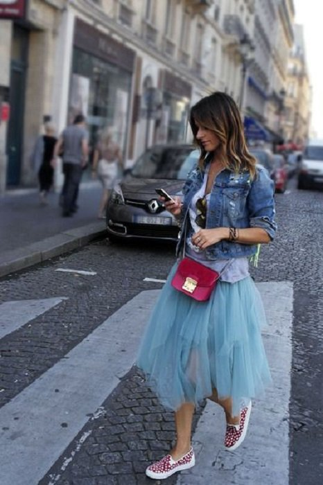 Girl wearing sky blue tulle skirt and denim jacket