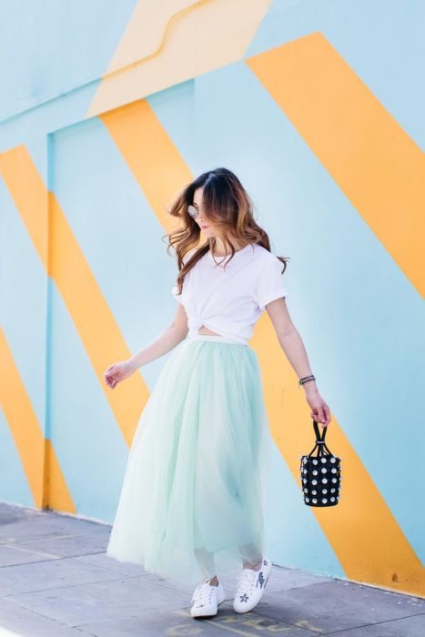 Girl wearing mint tulle skirt with white blouse