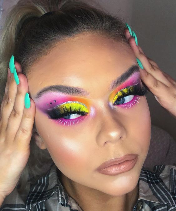 Brunette girl with pink, yellow and purple eye makeup