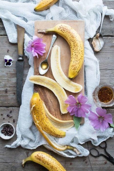Male banana cut in half for facial mask