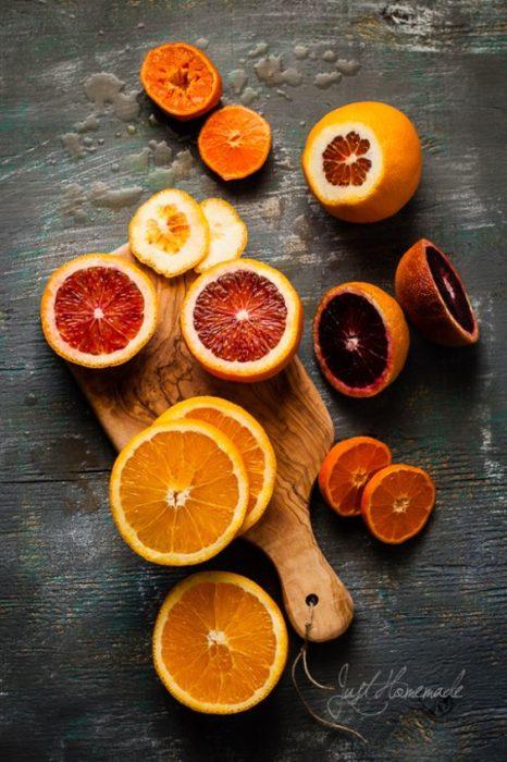 Sliced orange for facial mask on a wooden board
