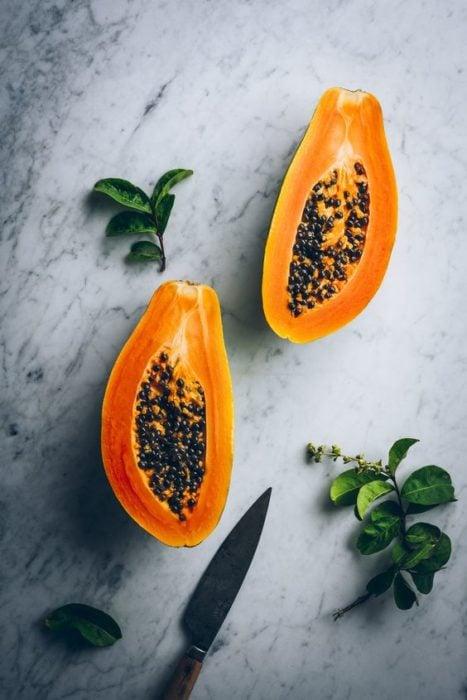 Papaya cut in half to make a face mask