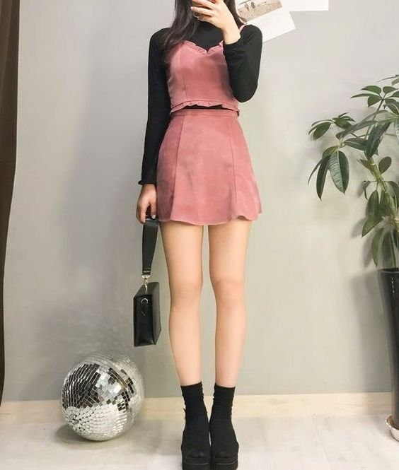 Girl taking selfie with black high neck blouse with red dress and black shoes