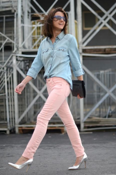 Girl wearing outfit with baby pink details in jeans and denim shirt, plus silver shoes