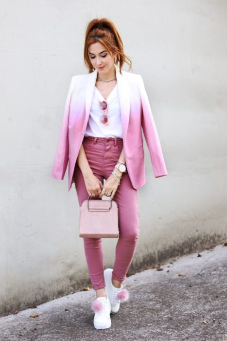 Girl wearing outfit with baby pink details in jacket in gradient from white to pink and pale pink jeans