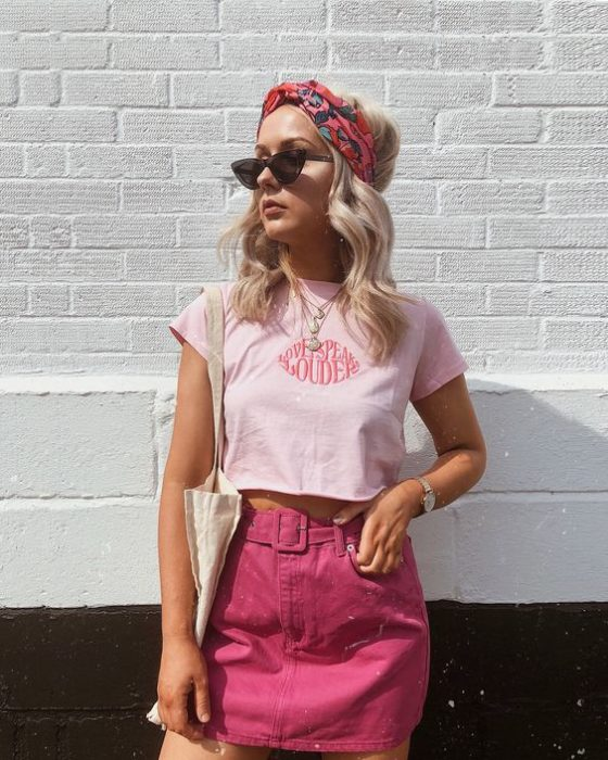 Girl wearing outfit with baby pink details in top blouse and fuchsia pink skirt