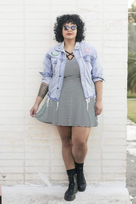Plus size girl in white striped dress with black and denim jacket