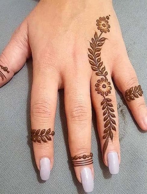 Henna leaf tattoo on fingers