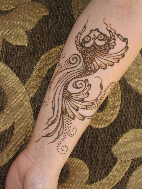 Koi fish henna tattoo on arm