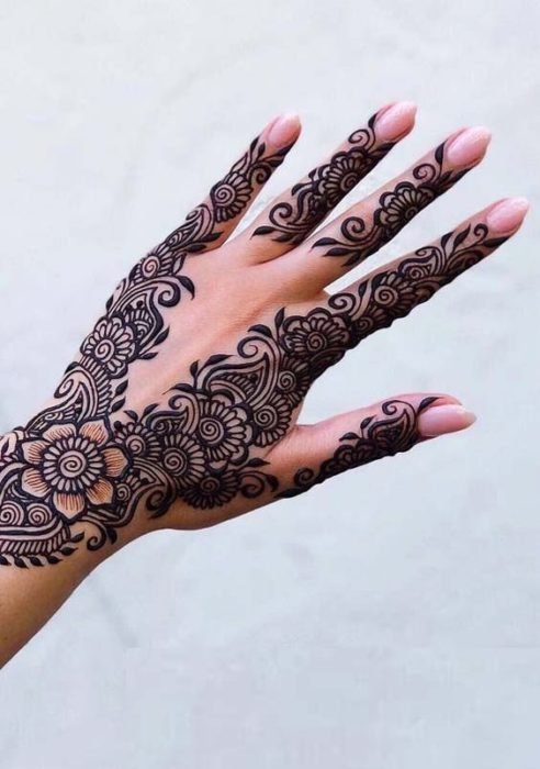 Henna tattoo on hand with flower details