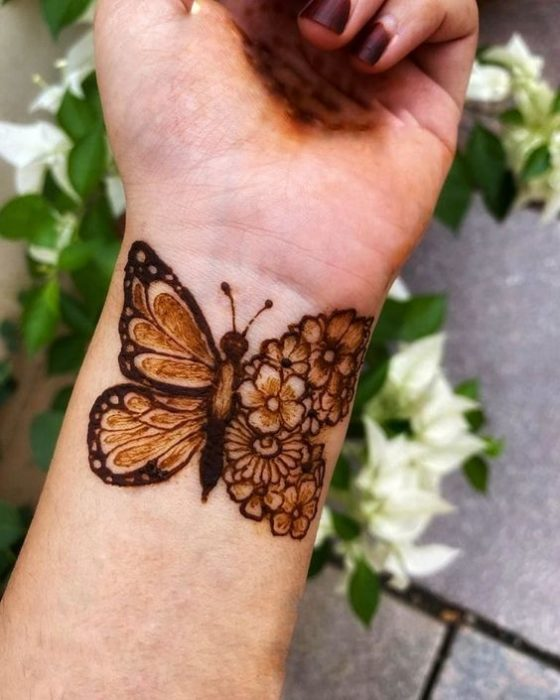 Henna butterfly tattoo on wrist