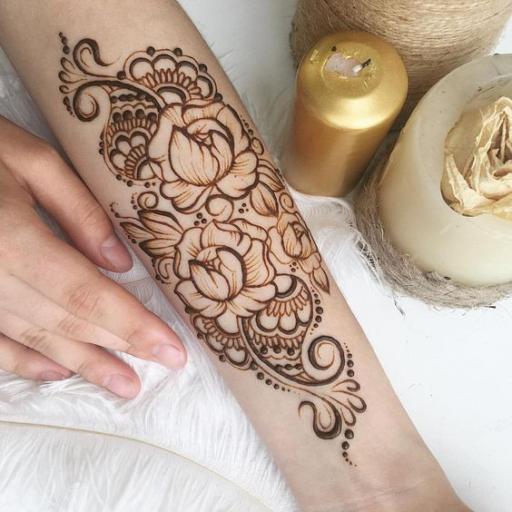 Henna tattoo of peonies on the arm