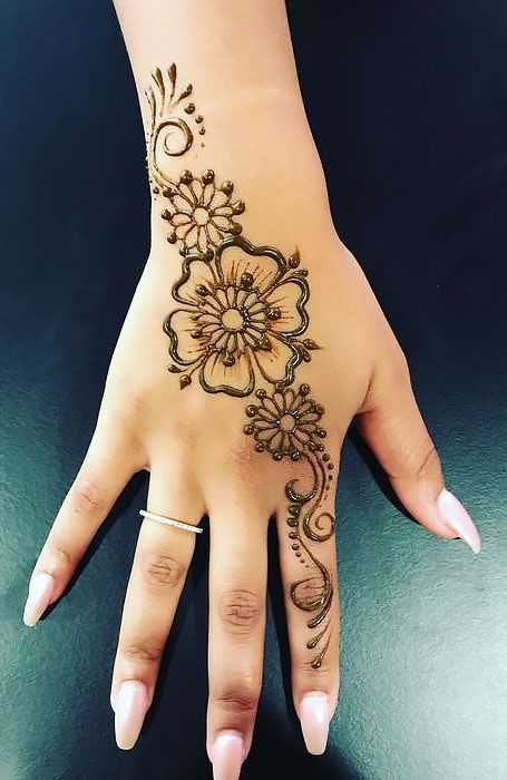 Flower henna tattoo on hand