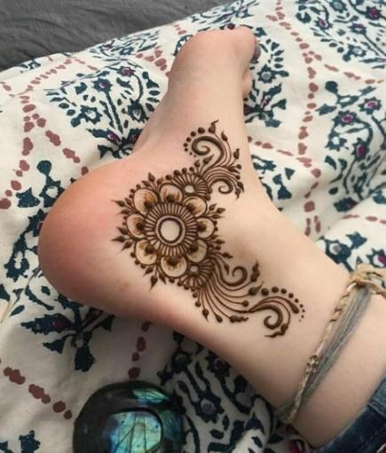 Flower henna tattoo on heel