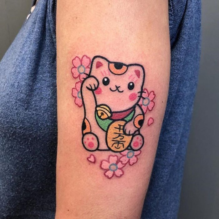 Tender kawaii tattoo on arm, Chinese lucky cat