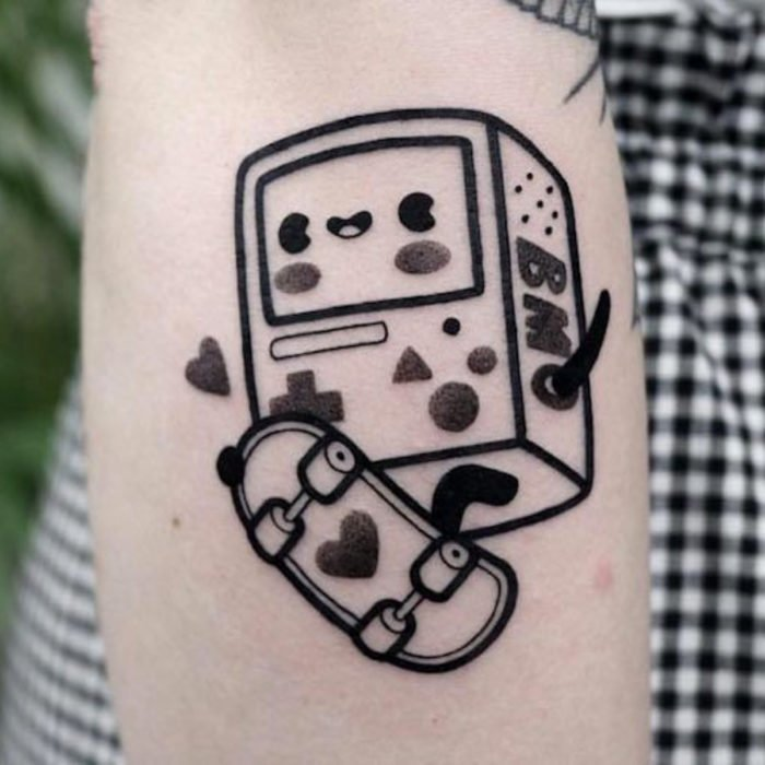 Cute kawaii tattoo on the arm of BMO on skateboard, Adventure Time