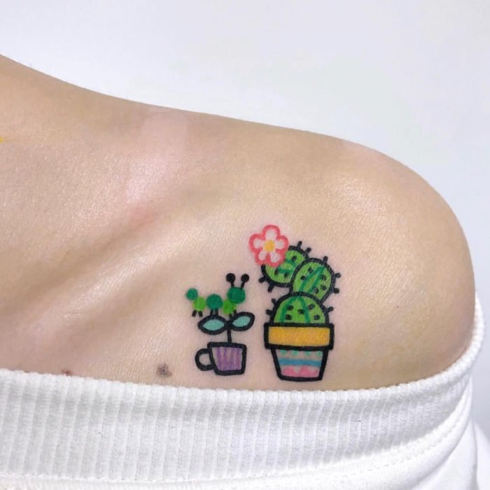 Cute kawaii shoulder tattoo of cactus and succulent pots
