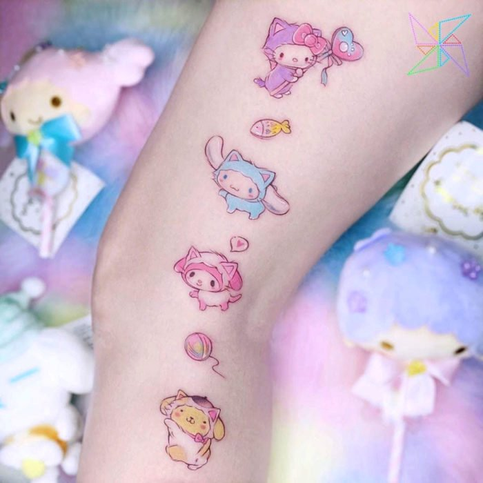 Cute kawaii tattoo on the leg of kittens and Hello Kitty in disguise, pastel colors