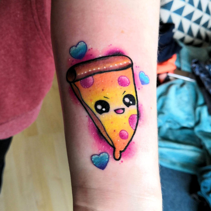 Tender kawaii pizza tattoo on arm with angry face and blue hearts