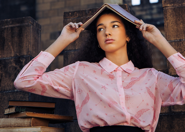 model wearing pink hedwig print blouse
