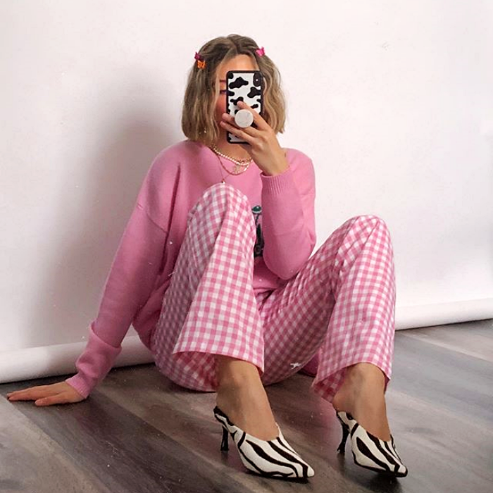 blonde girl wearing pink sweater, pink pants with white plaid and zebra print heels