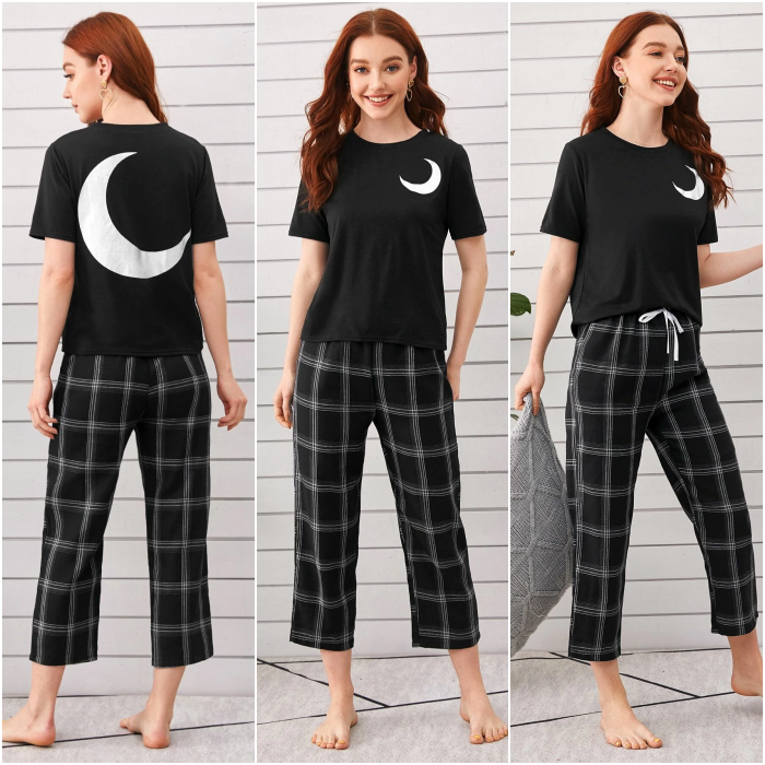 long-haired girl wearing black pajamas with short-sleeved t-shirt and baggy shorts with moon print and plaid with white lines