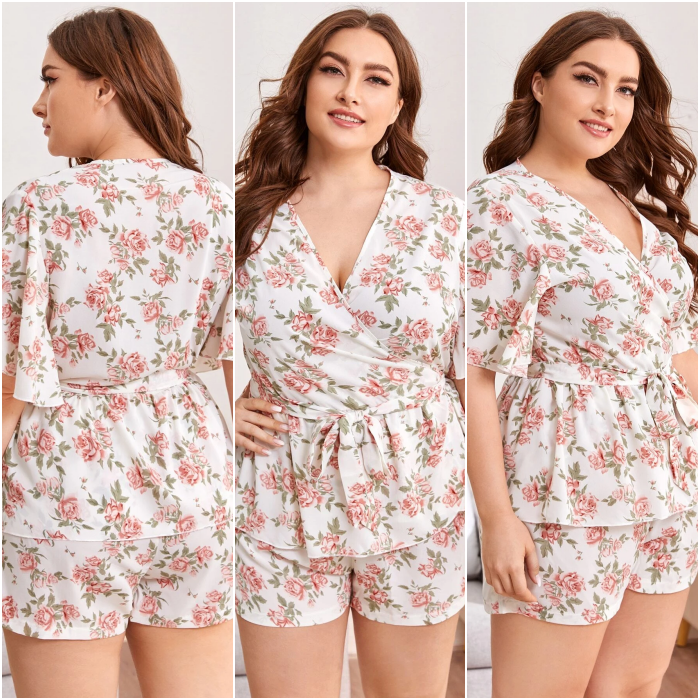 Curvy girl with long hair wearing cool white pajamas with pink flower print, short sleeves, V neck and short shorts