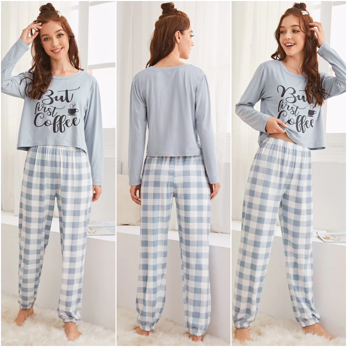 redhead girl wearing gray and white pajamas with long sleeve top and straight pants with gray lines