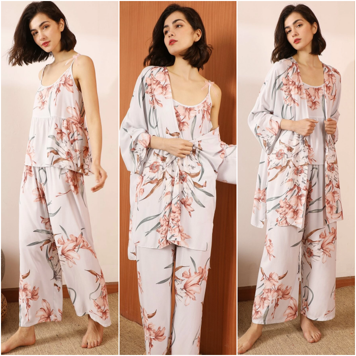 short dark hair girl wearing white pajamas with pink flower print with long robe, tank top and baggy pants