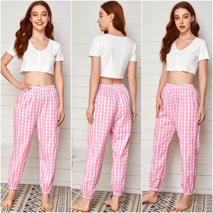 girl with long hair wearing pajamas with short-sleeved white crop top and pink pants with white lines