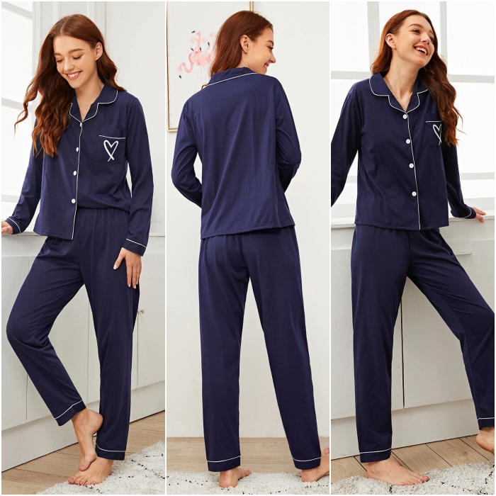 redhead girl wearing navy blue pajamas with button down shirt and long sleeves, straight pants