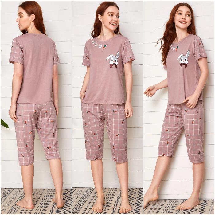 redhead girl wearing pink pajamas with short sleeve top and knee pants