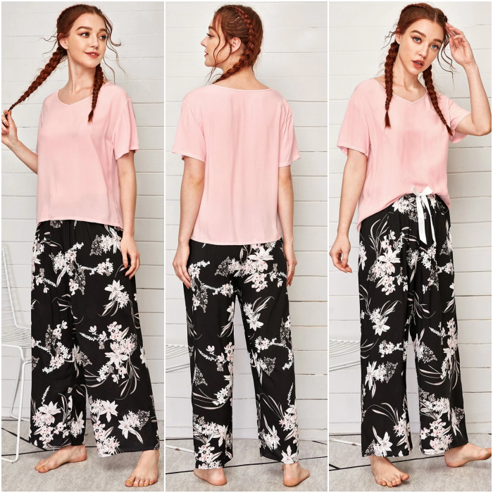 redhead girl wearing red short sleeve t-shirt pajamas and black baggy pants with flower print