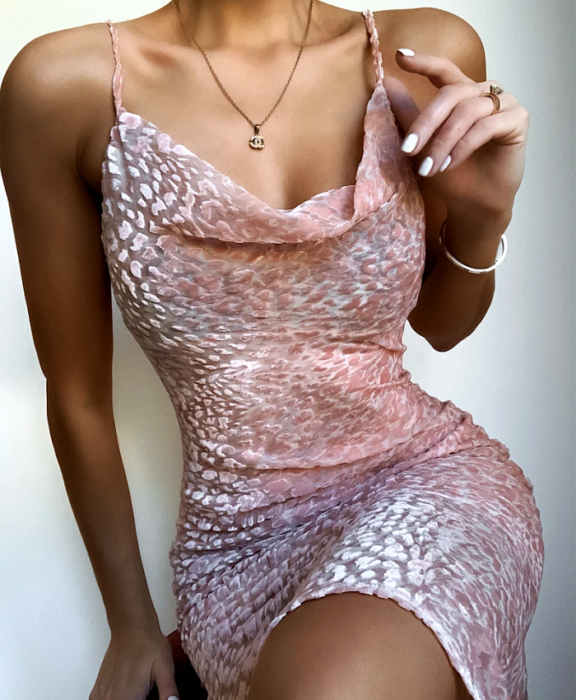 girl wearing pastel pink skintight dress with delicate print