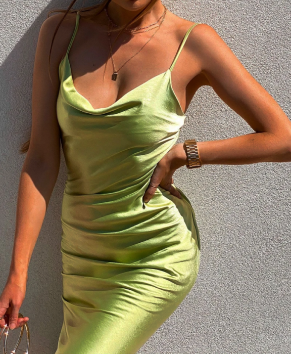 girl wearing lemon green satin bodycon dress with straps and loose neckline