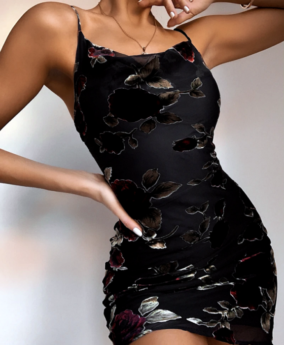 girl wearing black flower print bodycon dress with straps and square neckline
