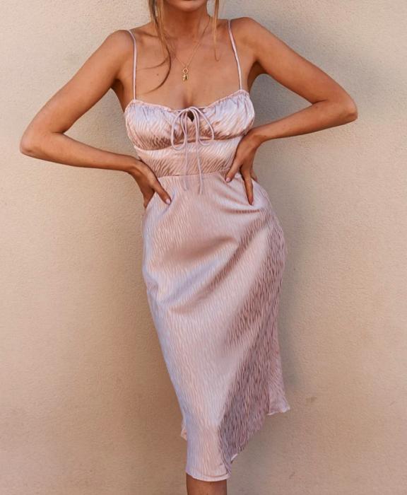 girl wearing pastel pink satin satin dress with spaghetti straps