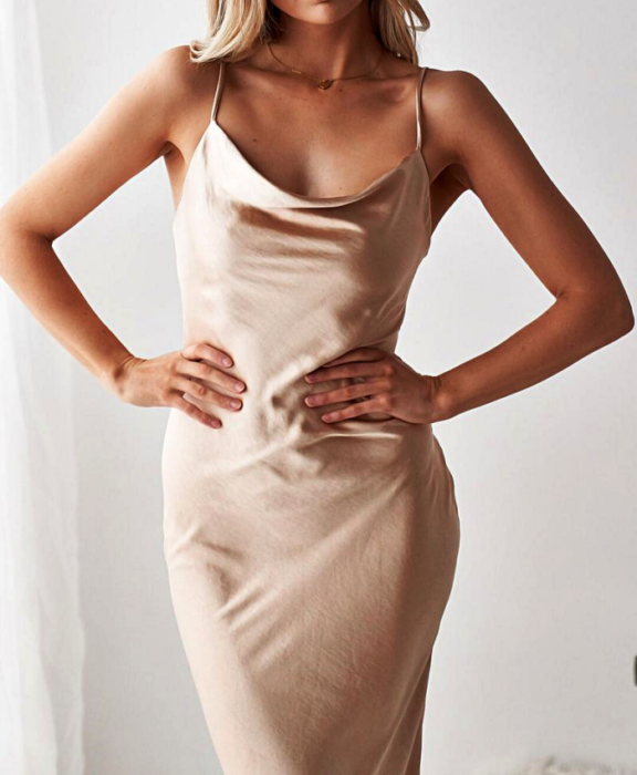 blonde girl wearing sand colored satin dress with straps
