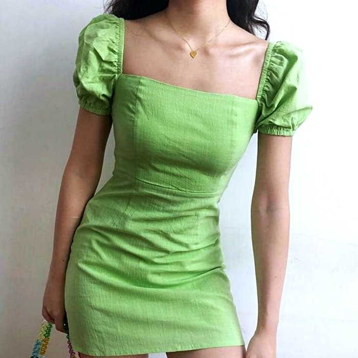 girl wearing bright green dress with square neckline and short sleeves