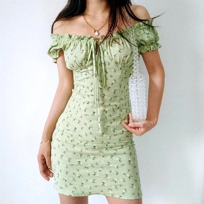 girl wearing country style dress, dropped off the shoulders with bow at the neckline and delicate flower print