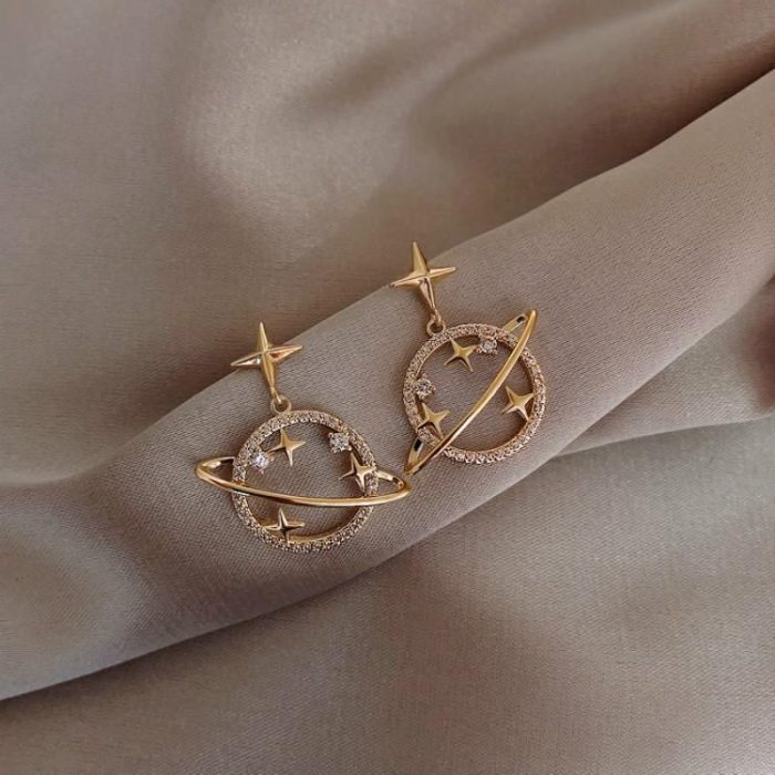 Saturn earrings with golden stars