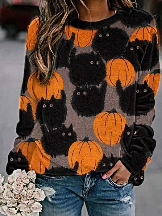 Suéter inspirada en Halloween con estampado de calabazas y gatos negros