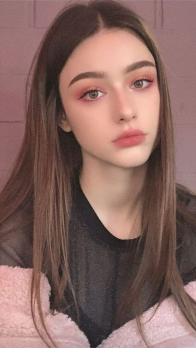 Girl with natural makeup in pink tones