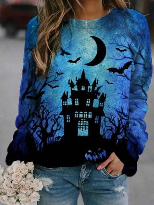Sudadera inspirada en Halloween, de color azul y estampado de casa embrujada