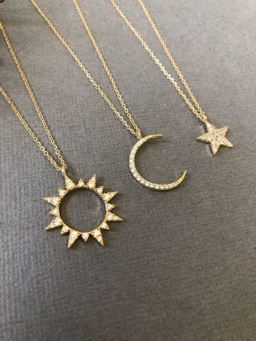 Chollares of moon, star and sun in golden color with pearl inlays